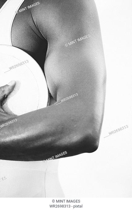 A female track and field athlete holding a discus in her hand