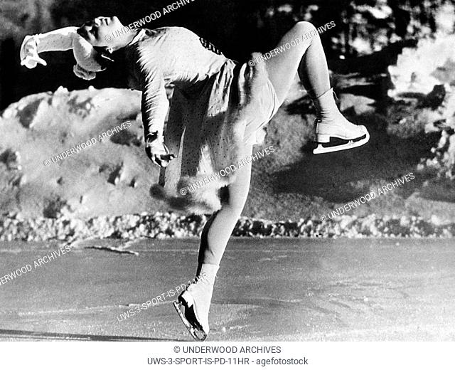 Switzerland: c. 1935.Miss Nadine Szilassy shows her beauty, grace, and poise as she strikes a pose on the ice in Switzerland