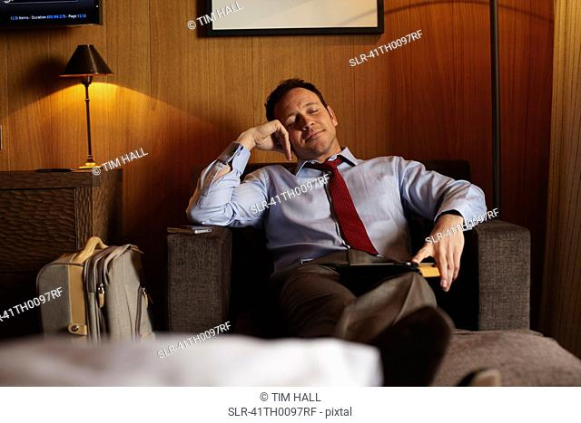 Businessman napping in hotel room