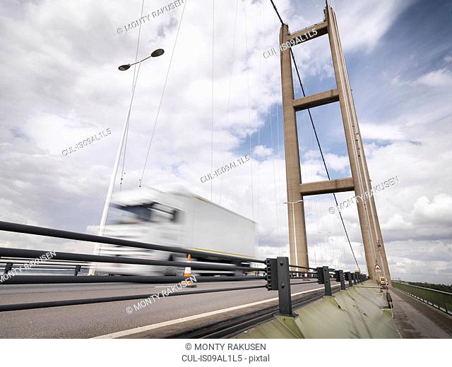 Traffic on suspension bridge. The Humber Bridge, UK was built in 1981 and at the time was the world's largest single-span suspension bridge