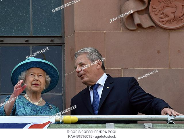 Britain's Queen Elizabeth II and German President JoachimGauck talk as they stand on the balcony of the Roemer in Frankfurt/Main,Germany, 25 June 2015