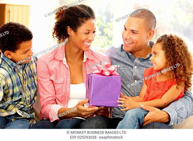Family giving gift to mother