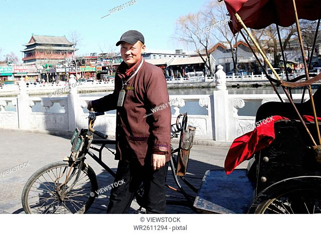 Human rickshaw driver