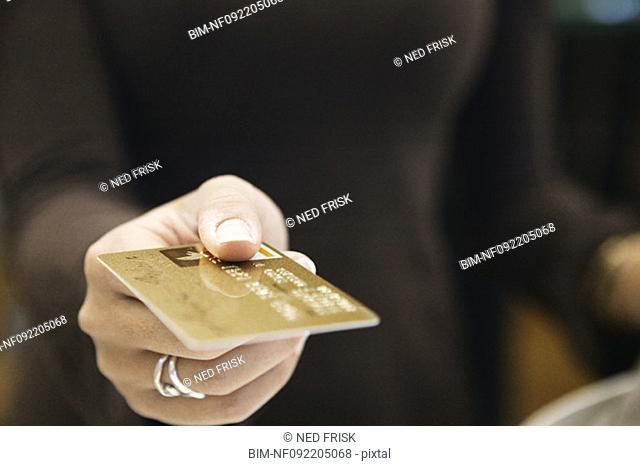 Young woman paying with a credit card