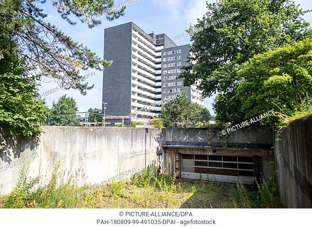 12 July 2018, Germany, Gladbeck: The former entrance to the underground car park of the Business Centre North and the associated high-rise building has become...