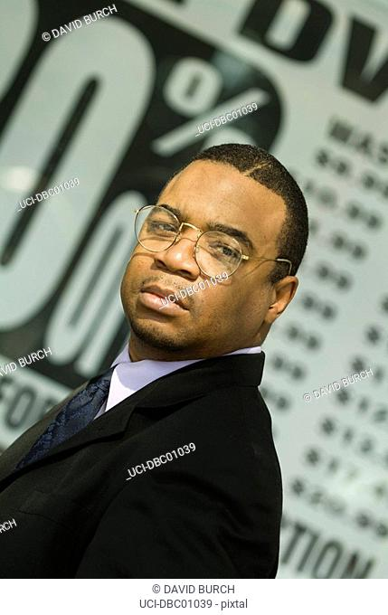 African businessman in eyeglasses and suit