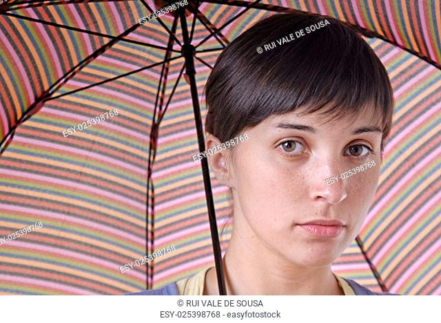 young brunette girl with umbrella in colors