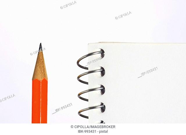 Spiral notebook and pencil, detail