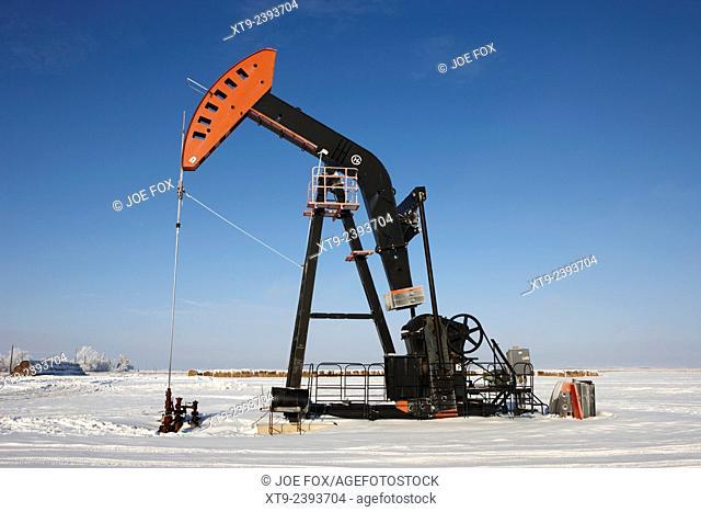 oil pumpjack in winter snow Forget Saskatchewan Canada