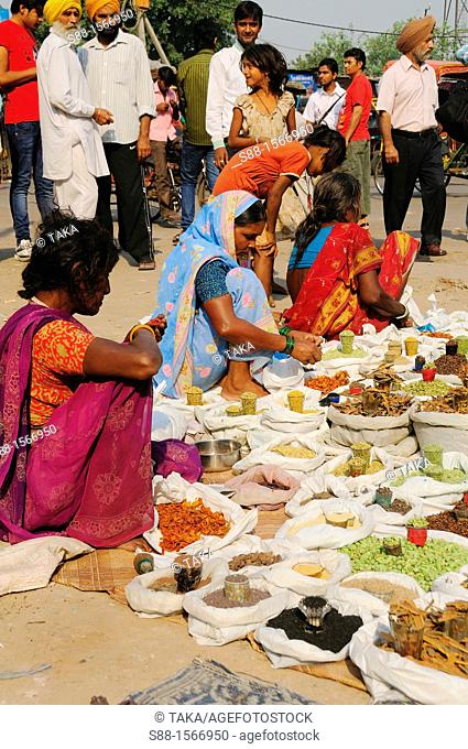 Women selling spices in Old Delhi