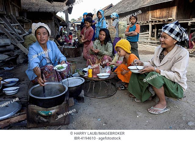 Food stall on the street in a Palaung village, locals sitting and eating, near Kyaing Tong, Shan State Golden Triangle, Myanmar