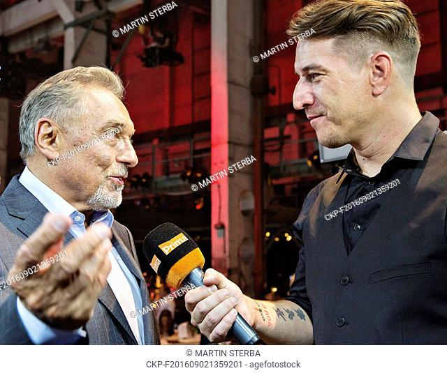 Czech singer Karel Gott, left, gives an interview to Czech TV Prima reporter Tomas Kraus, as he attends the presentation of the new large SUV Skoda Kodiaq to...