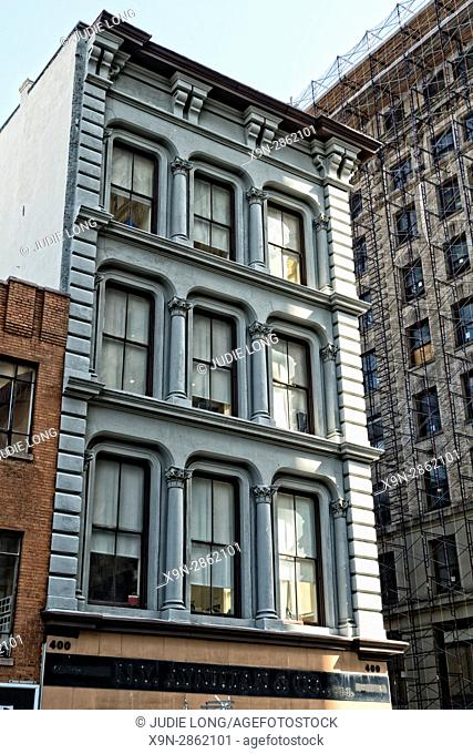 New York, NY. Looking up at the Upper Floors of a Cast Iron Historic Tenement Building