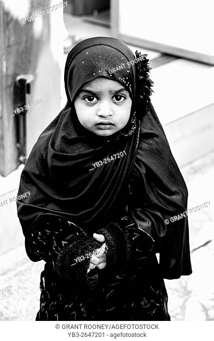 A Young Omani Girl Wearing A Hijab, Muttrah Souk (Al Dhalam), Muscat, Sultanate Of Oman
