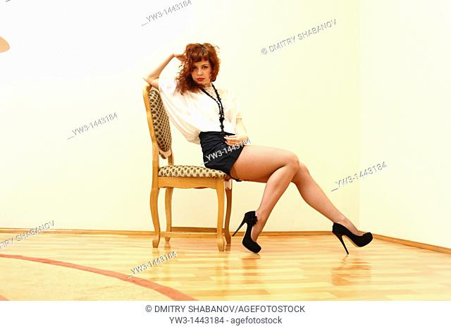 Pretty redhead young woman portrait indoors