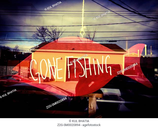 Gone Fishing sign, indicating the store is closed, in a fishmonger's shop, Nova Scotia, Canada