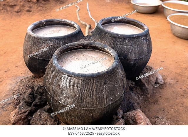 Casks of millet beer, Burkina Faso