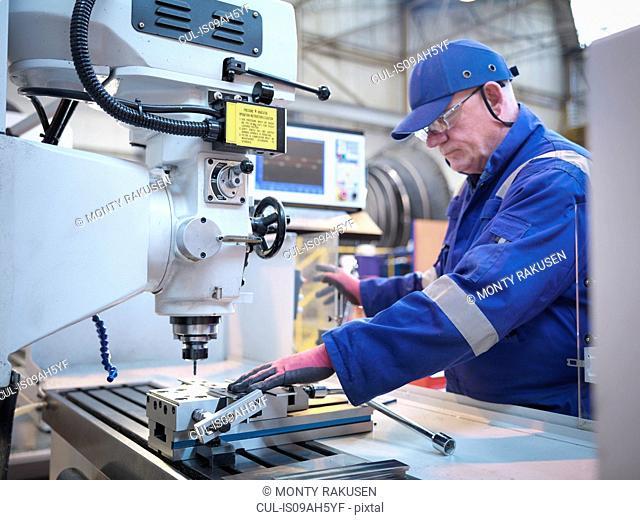 Engineer preparing lathe in steam turbine repair works