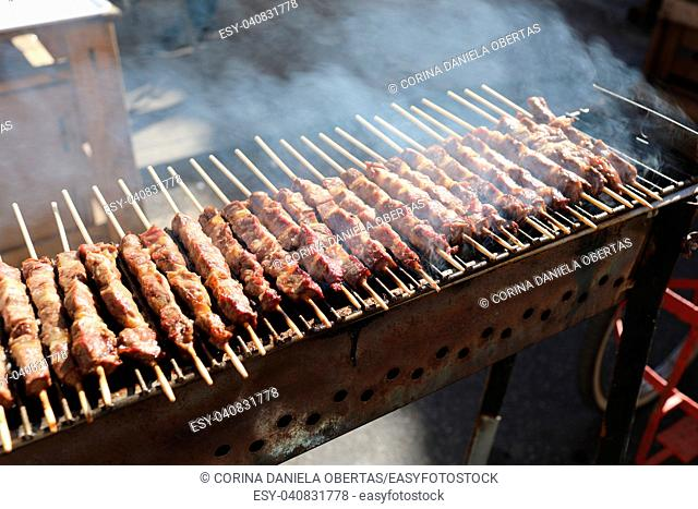 Grilled lamb skewers sizzling on barbecue, among the most popular street food in the world