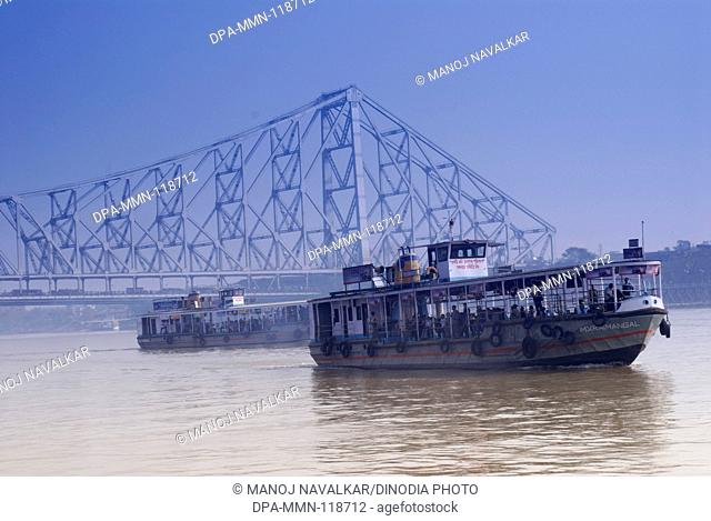 View of Howrah bridge on Hooghly river at Calcutta ; West Bengal ; India