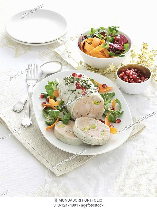 Salmon mortadella with a colourful salad and pomegranate seeds