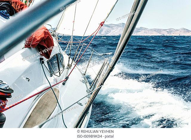 Aboard view of yacht sailing through ocean waves near coast, Croatia
