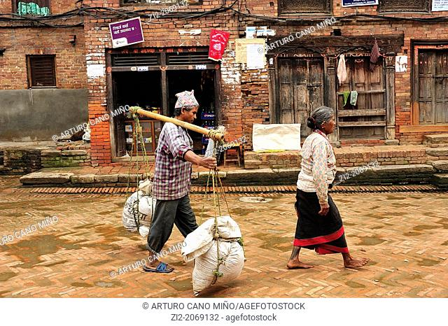 Woman and porter man, Bhaktapur, Nepal