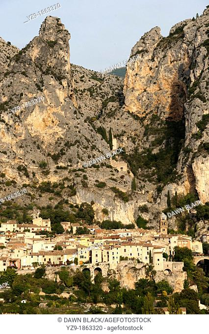 Moustiers Sainte Marie nestling beneath the cliff, Provence, France