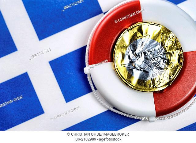 Euro coin made from crumpled foil on a life buoy and the Greek flag, symbolic image, euro rescue for Greece