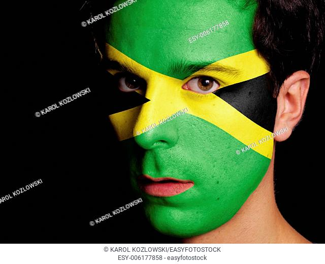 Flag of Jamaica Painted on a Face of a Young Man