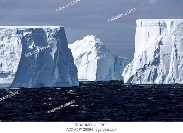Incredibly large tabular icebergs float through the antarctic Sound near the top of the Antarctic Peninsula, Antarctica