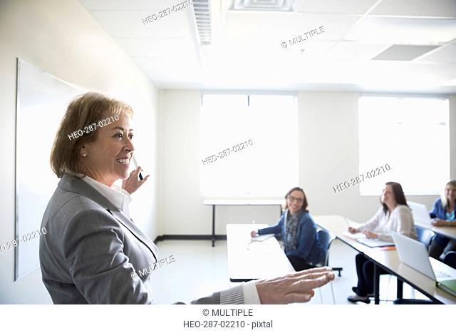 Professor leading adult education class