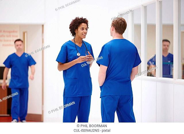 Doctors having discussion in hospital