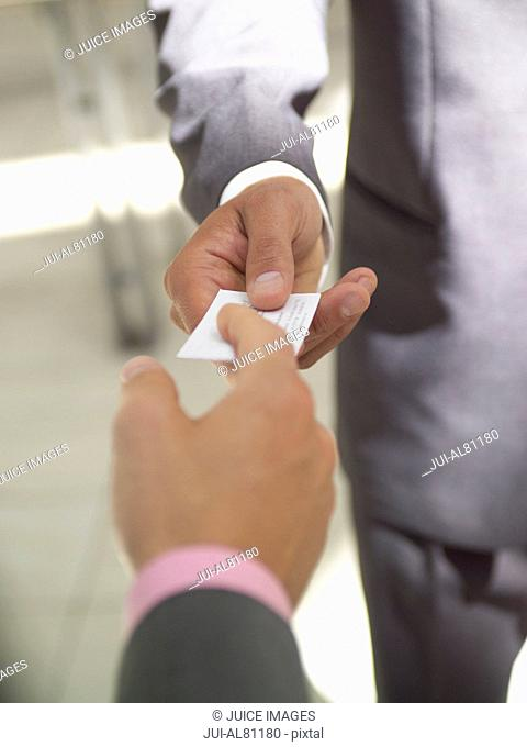 Businesswoman and businessman exchanging business card