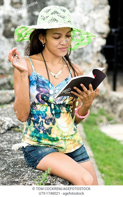 Young woman with notebook in Fort San Pedro, Cebu City, Philippines