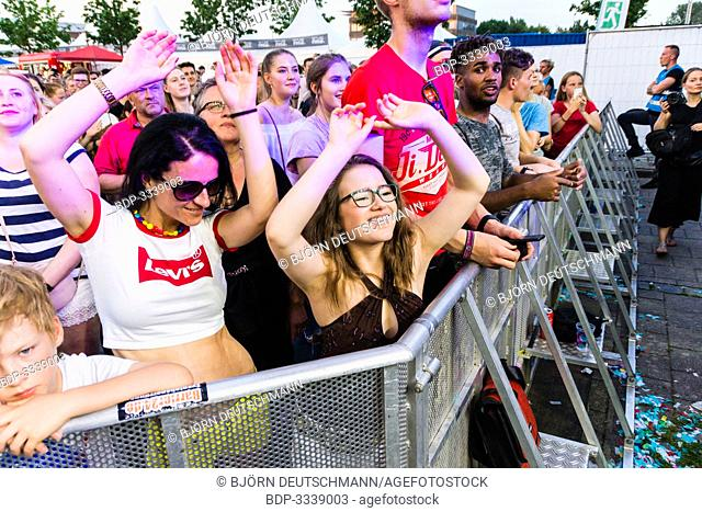Kiel, Germany - June 25th 2019:  Mother & daughter are dancing to the Party Music from the French deep house duo Ofenbach is performing on the Hörn Stage