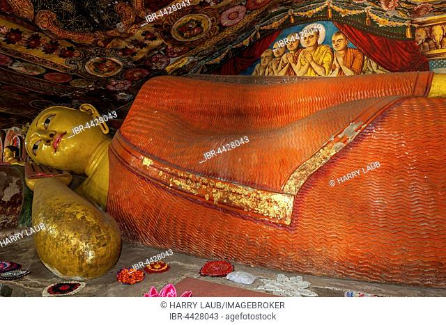 Reclining Buddha statue and painted ceilings, Aluvihara Rock Cave Temple, Central Province, Sri Lanka