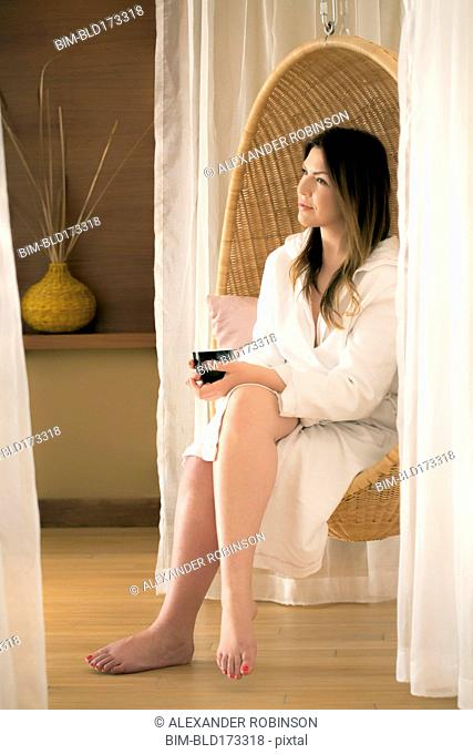 Caucasian woman sitting in spa chair