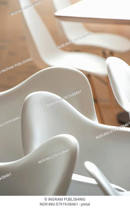 Abstract modern interior of cafe or meeting room with rounded armchairs