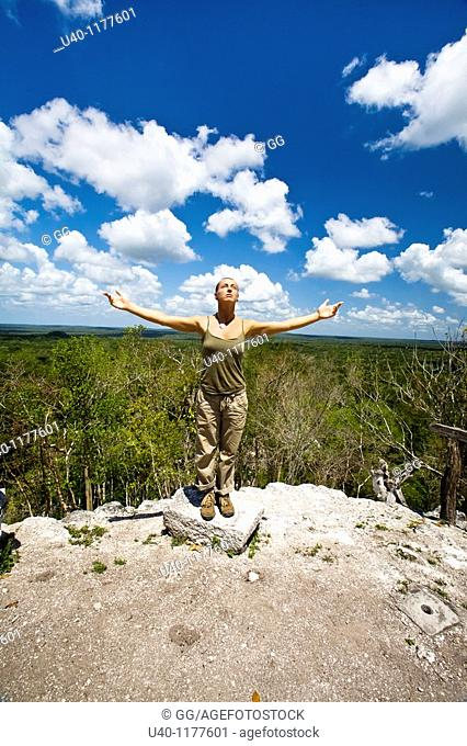 Guatemala, Peten, El Mirador, woman with outstretched arms