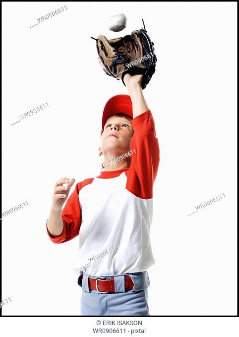 Close-up of a baseball player catching a baseball