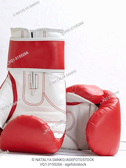 pair of leather red white boxing gloves on a white background, close up