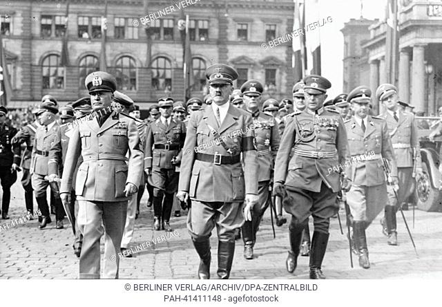 The image from the Nazi Propaganda! shows Adolf Hitler and the Italian Prime Minister Benito Mussolini after his arrival upon leaving Munich Central Station in...