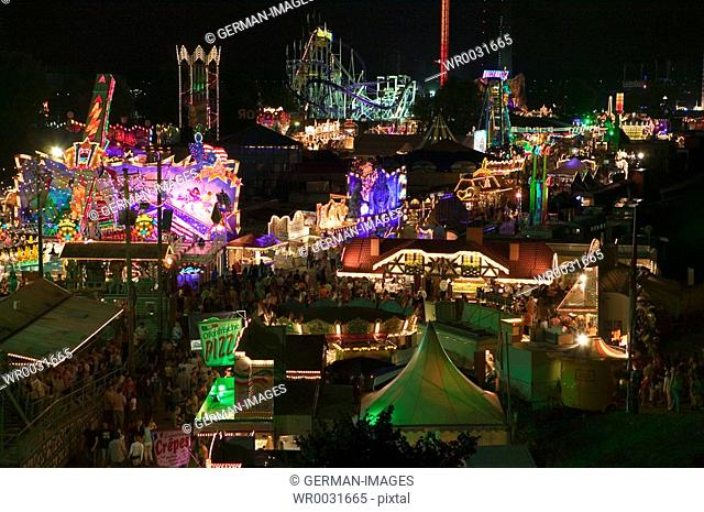 High angle view of people in amusement park at night