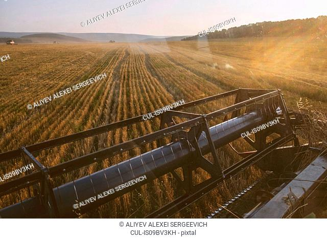 Harvested field landscape view from combine harvester