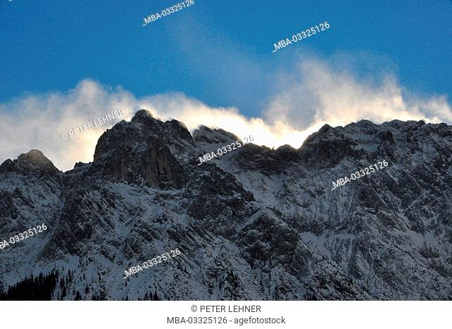 Germany, Bavaria, Mittenwald, Karwendel mountains, main ridge, Schneeverwehung, back light
