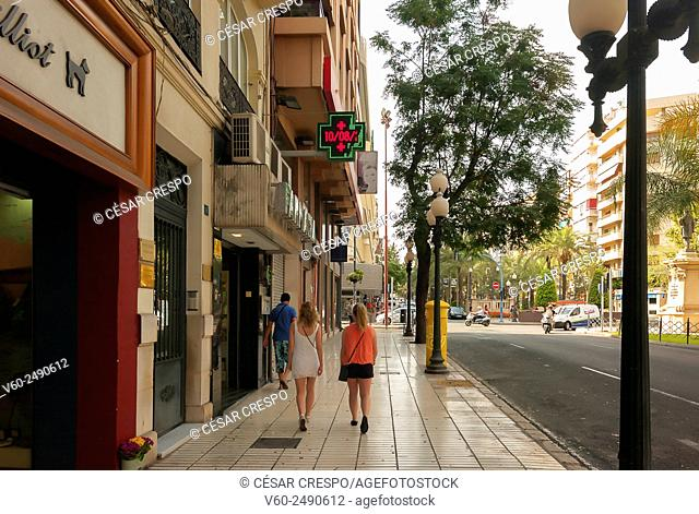 -Young women walking the streets- Alicante (Spain)