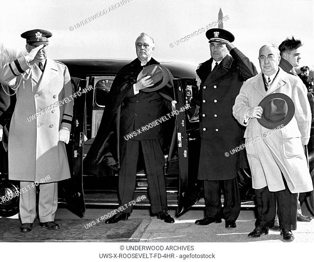 Washington, DC: February 12, 1942.President Roosevelt stands with his hand over his heart as his aide walks up the long steps to the Lincoln Memorial to lay a...