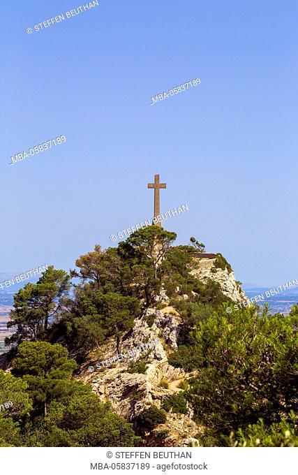 Creu d'es Picot, metres-high stone cross with the Santuari de Sant Salvador, close Felanitx, the east of the island Majorca, the Balearic Islands, Spain