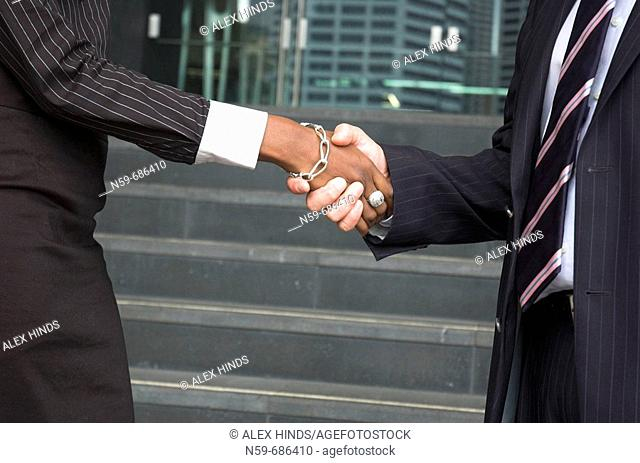 Male and female businesspeople shaking hands
